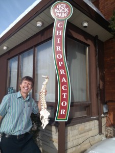 Our newest sign from Creecher's Design, 2015. Dr. Kevin with our spine used in his talks.